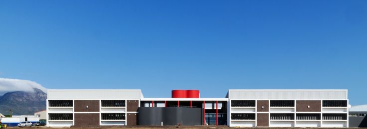 Kensington High School - exterior view, grey & red central feature