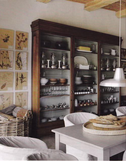 Open wooden shelving in the kitchen.