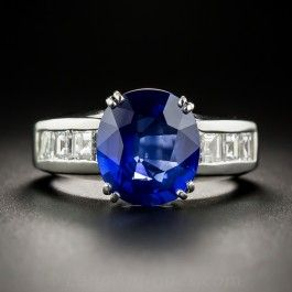 A gorgeous velvety cobalt blue sapphire, weighing 4.07 carats, extremely similar in color and effect to a rare Kashmir stone, radiates between rows of flashing white square-cut diamonds in this superb and stunning estate jewel sturdily fabricated in platinum. 1.01 carats total diamond weight. Currently ring size 6 1/4 with re-sizing limited to 1 size up. Accompanied by a gemological report from Stone Group Laboratory stating: Natural, Indications of Thermal Enhancement, Ceylon (Sri Lanka)…