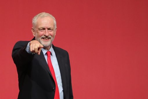 LIVERPOOL, ENGLAND - SEPTEMBER 24: Jeremy Corbyn MP gestures to supporters after being announced as the leader of the Labour Party on the eve of the party's annual conference at the ACC on September 24, 2016 in Liverpool, England. The leadership battle between Jeremy Corbyn and MP for Pontypridd Owen Smith, was triggered by Labour MPs who were unhappy with Mr Corbyn's leadership in the run up to the Brexit referendum. (Photo by Christopher Furlong/Getty Images)