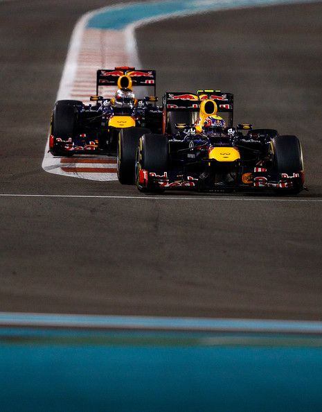 Mark Webber of Australia leads his team mate Sebastian Vettel of Germany and Red Bull Racing during the Abu Dhabi Formula One Grand Prix