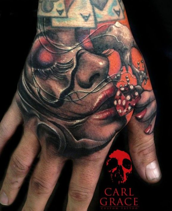 Kissing dice is supposed to bring luck. Fantastic hand tattoo by Carl Grace!