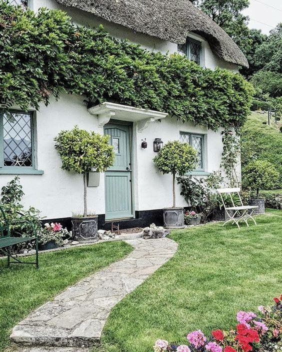 Collecting examples of white stucco with blue, green and grey trim - here is an excellent one