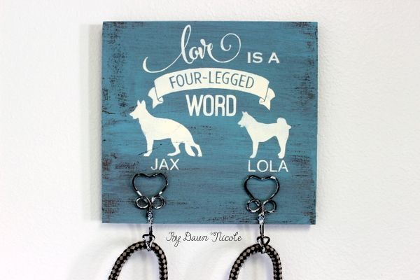 Hometalk :: DIY Dog Leash Holder~~~Cute idea!  Wood plaque painted and hung on wall for leashes.