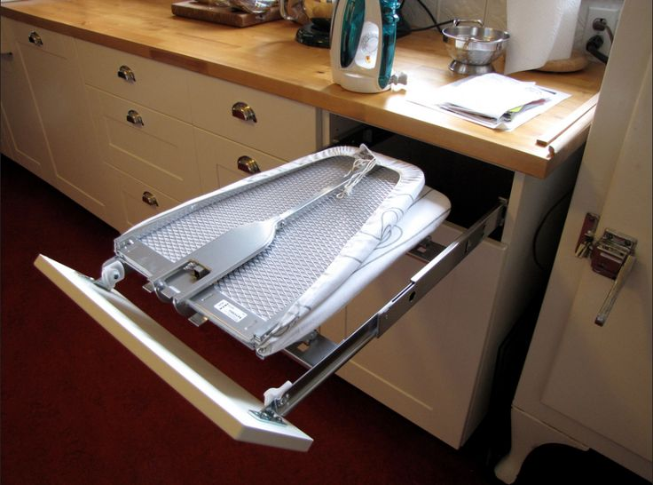 Hide your ironing board by tucking it away in a foldable drawer! It rolls completely out of sight.