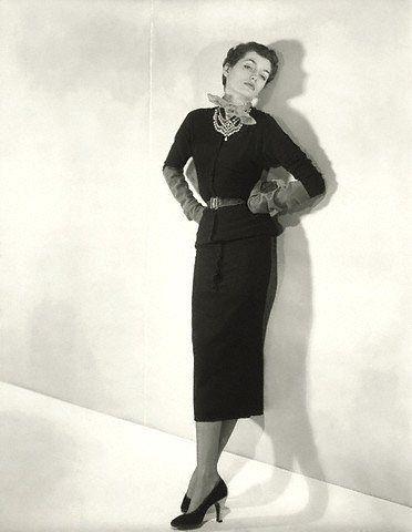 Countess Maxime de la Falaise modeling a long, narrow black sweater dress she designed for Paquin, 1950  Photo by Horst P. Horst