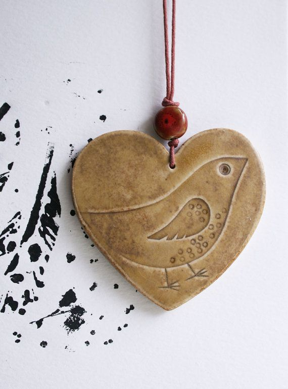 Handmade ceramic pendant by jolucksted