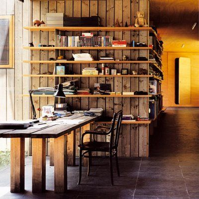 Work Station: corner wrapped shelves, reclaimed wood cladding extending into table top....