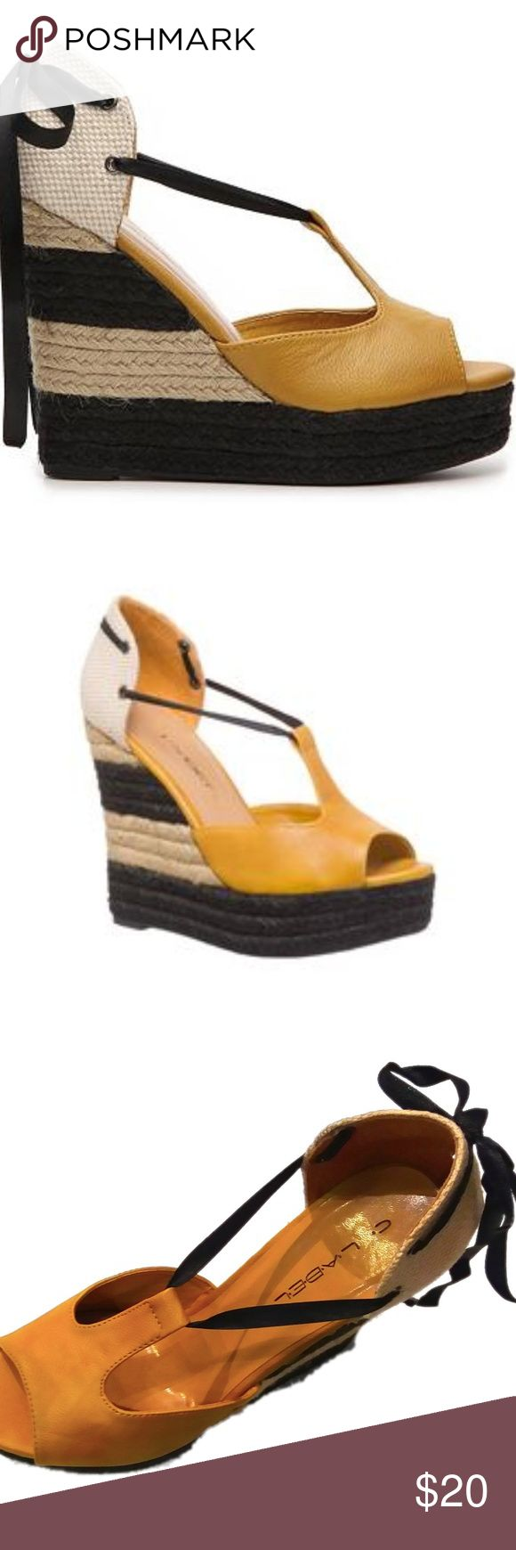 "Yellow Woven Wedge Key Features: Summery golden color with pretty black ribbon accent Ribbon can be tied in the front or back for added personal style Black and Tan large striped woven wedge Synthetic lower; Man made faux leather upper materials  Heel measures approximately 4.75""  Platform measures approximately 1.5"" US Women sizes. C-Label Shoes Sandals"