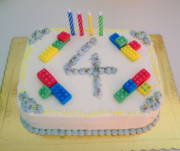 same rainbow cake decorated with fondant lego ready for our school party!