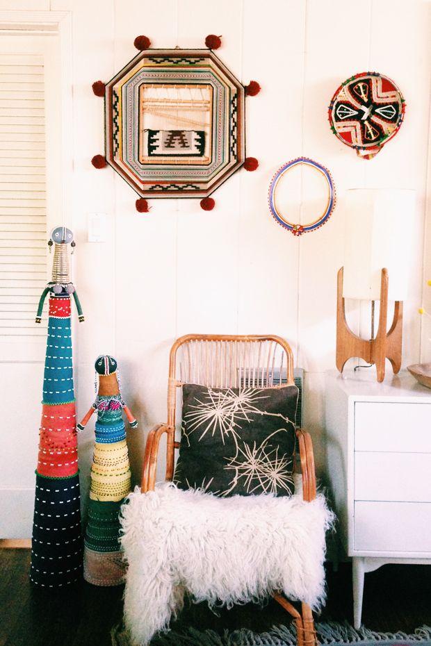 Ndebele Fertility Dolls, Wall weaving, Peruvian hat, Massai necklace, rattan chair, sheepskin, mid-century lamp.