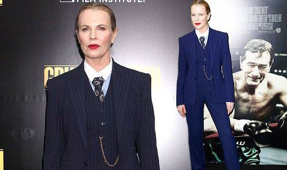Kim Basinger goes all androgynous as she dons gangster style suit at Grudge Match premiere