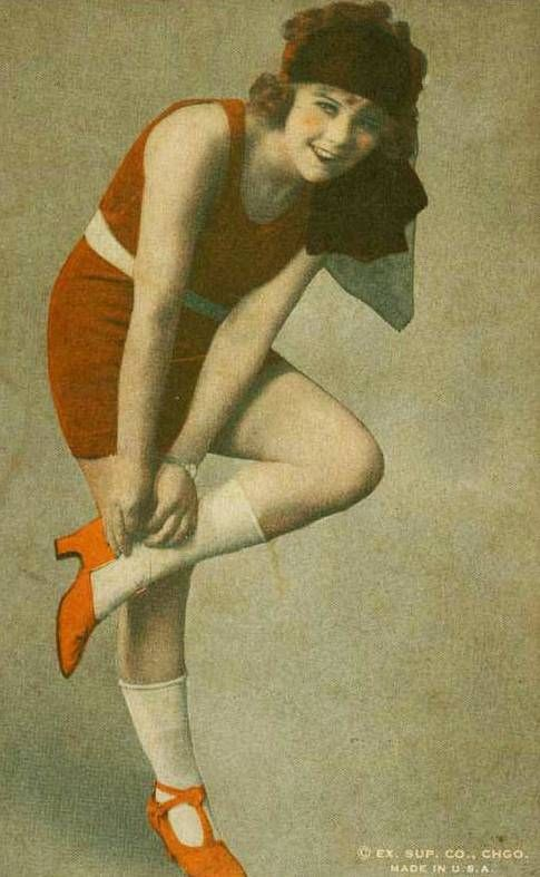 ARCADE CARD - EXHIBIT SUPPLY COMPANY - PIN-UP - WOMAN IN RED ADJUSTING SHOE