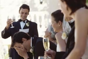 Best man making a speech on the head table at a wedding reception - Fuse/Getty Images