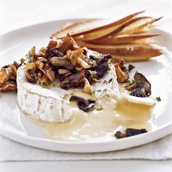 Warm Camembert with Wild Mushroom Fricassee | Daniel Boulud makes this oozy appetizer with Vacherin Mont-d'Or, a creamy cheese sold at top cheese shops. Camembert is as rich and runny as Vacherin Mont-d'Or, but much easier to find.