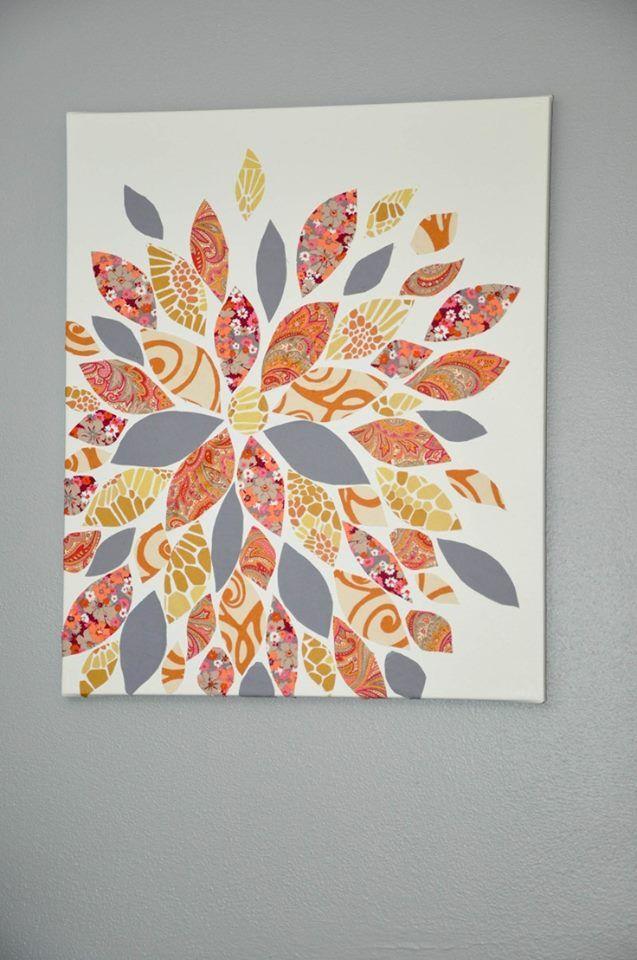 Uma tela de pintura e recortes de revista ou tecido em formato de folhas