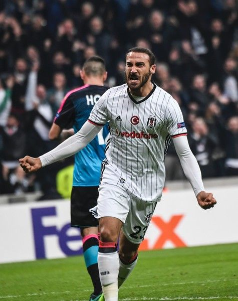Besiktas's forward Cenk Tosun celebrates scoring during the UEFA Europa League football match Besiktas vs Hapoel Beersheba (Beer Sheva) on February 23, 2017 at the Vodafone Arena in Istanbul.  / AFP / BULENT KILIC