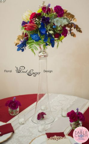Same flower arrangement, different centerpiece decor and linen! Linen from The Table Cloth Hiring Company.