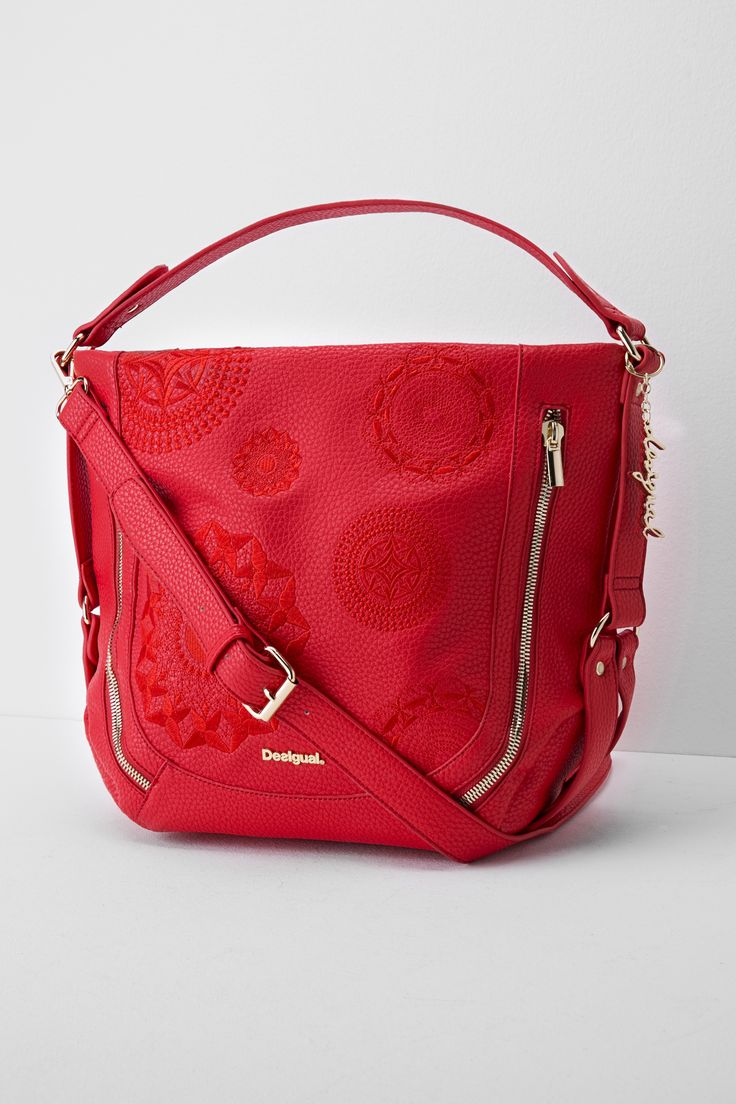 This red bag with mandela etchings is the perfect accompaniment to any outfit this season. It's versatile and practical enough to be worn on a daily basis, but that doesn't mean that it's not special!