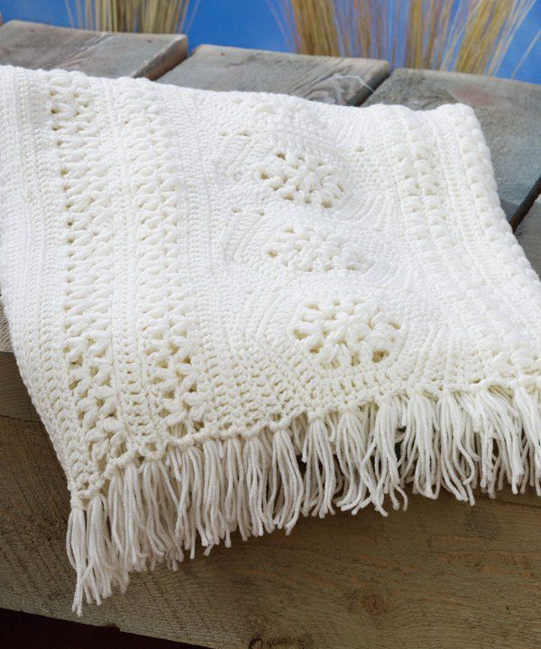 Keeping it Classic Crochet Afghan Pattern - Granny squares and crochet panels make this vintage crochet blanket a dream to make