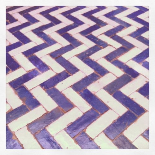 I am really digging all of the architectural tile floors these days.  This Moroccan chevron tile floor is a hit!! I don't know if purple would be my accent color, but I can appreciate it.