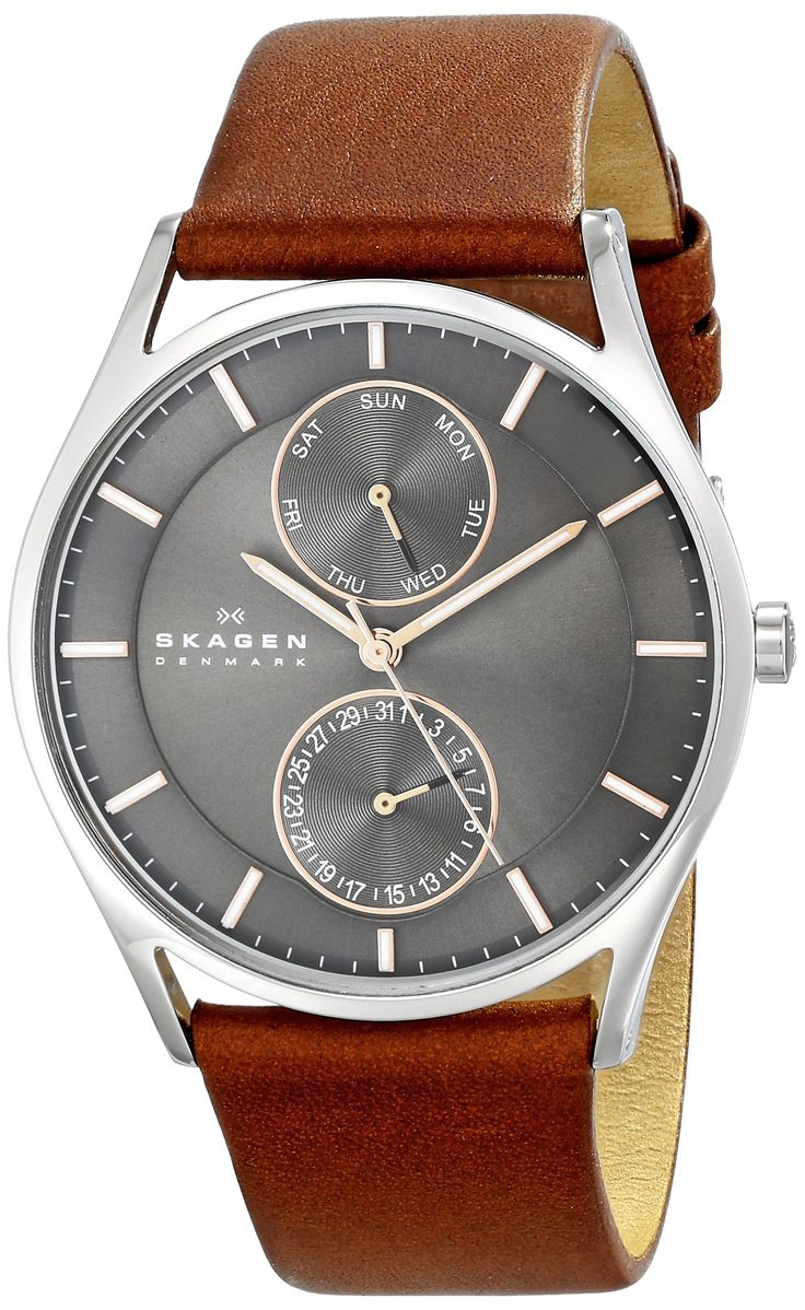 very nice colour contrasts. i like that it has the day/date in a classy way (vs the usually less than sophisticated box with date). very nice watch. love the complementing strap. probably my favourite skagen