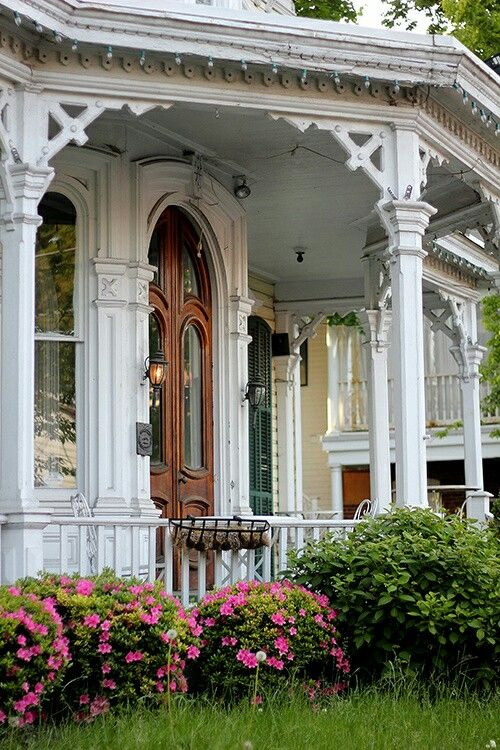 Victorian white house with welcoming front porch