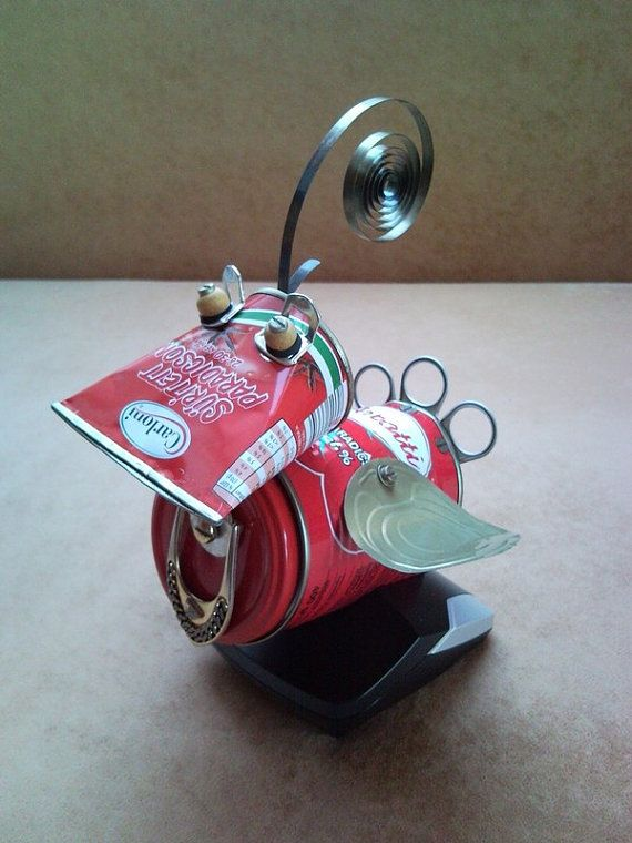 Tomato red bird of Paradise sits in her phone charger nest - recycled tin can metal sculpture, junk art, home decoration