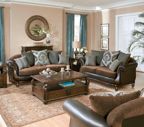 Brown sofas, blue pop's and cream colored wall's my Living room!