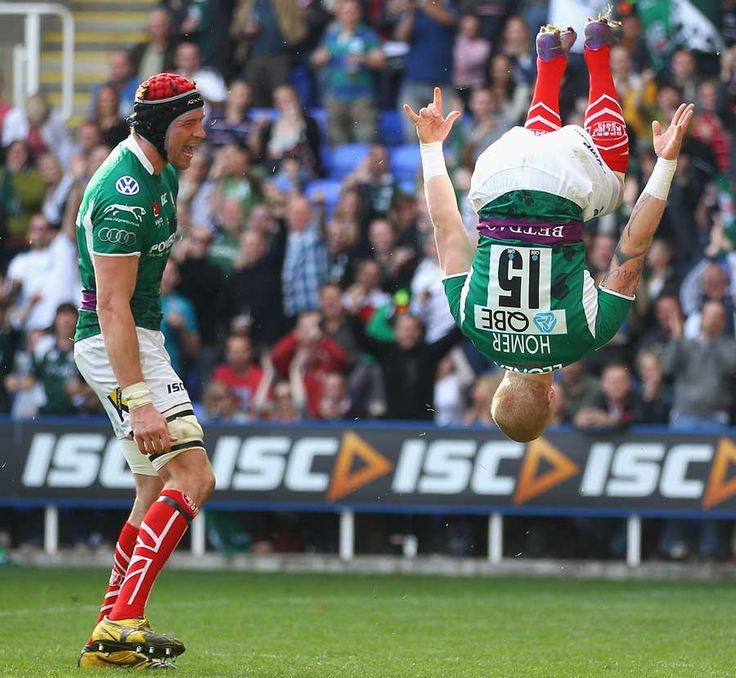 London Irish fullback Tom Homer goes airborne to celebrate a try, London Irish v Leicester Tigers, Aviva Premiership, Madejski Stadium, Reading, England, March 25, 2012