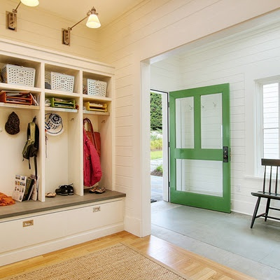 great mud room area. love the green door with glass panels!