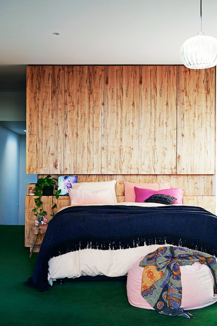 A timber feature wall anchors the pops of colour used in this master bedroom in a renovated Victorian terrace home. Photography: Diana Pritchard   Styling: Amber Lenette   Story: real living