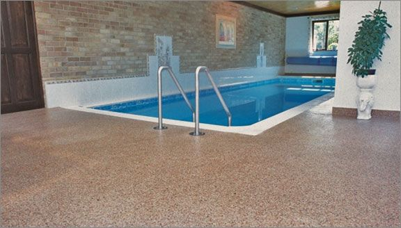 Resin flooring provides the ideal flooring coating for environments that house a swimming pool.