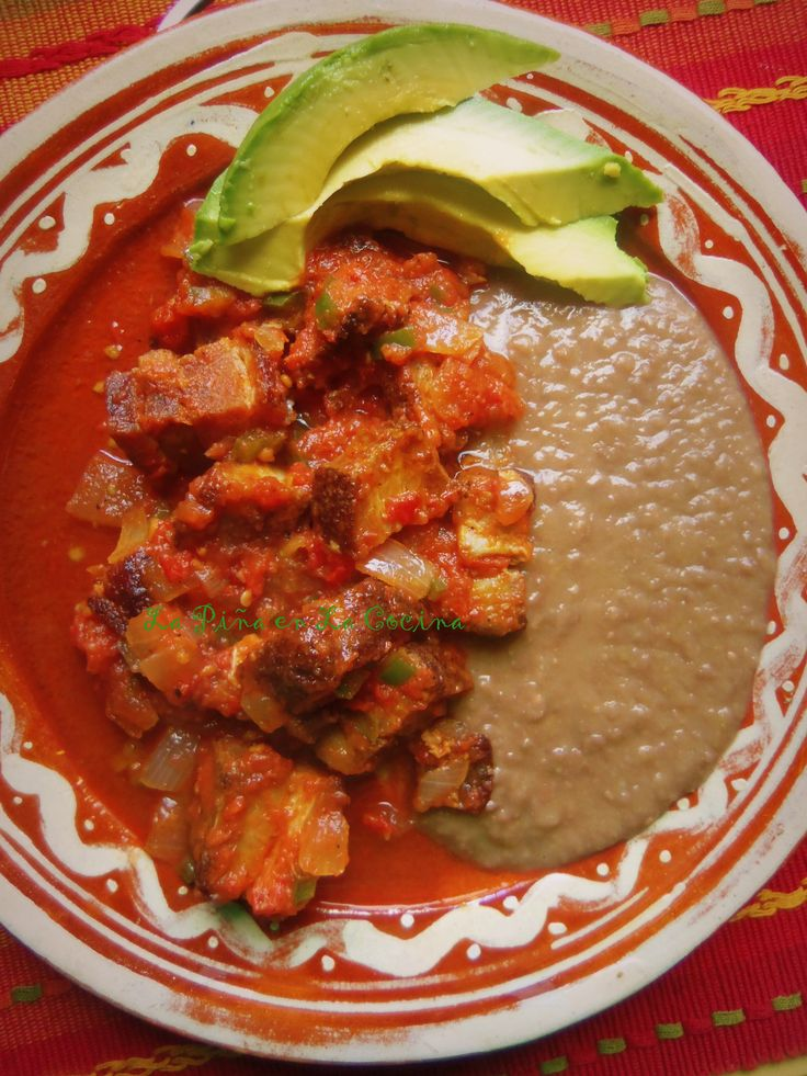 Chicharrones en Salsa Roja you must have some beans and avocado!