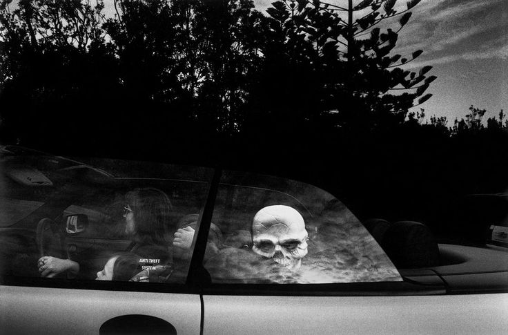 Trent Parke. AUSTRALIA. Sydney. A child with a skeleton mask arrives at a fancy dress party in Watsons Bay. 1998