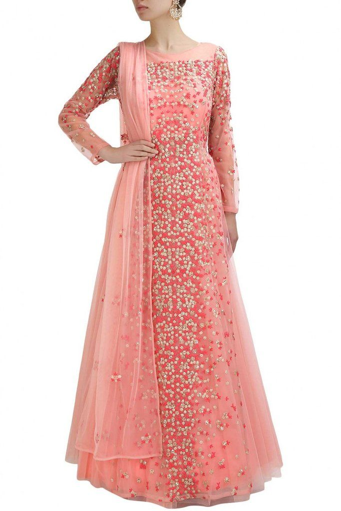 This pink color anarkali gown is in net fabric with resham and tikki floral embroidery all over. This pink color anarkali gown comes along with matching pink dupatta in net embellished motifs all over