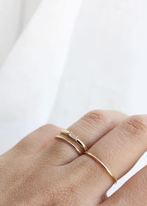 Our Baguette Diamond Ring is delicate and sophisticated, without being too stuffy. Set in a 14k solid gold band, it's built to go with you, no matter the circumstance. Size it to fit your ring finger,