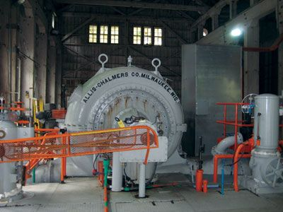 The Allis Chalmers horizontal Francis turbine inside the powerhouse drives a 4.7-MW capacity generator.  Hydro plant has been in operation for over 100 years.