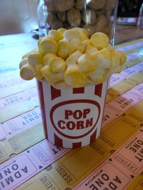 So cute - for kids parties - great website with instructions.  EASY MOVIE THEATER BIRTHDAY PARTY & POPCORN CUPCAKE DIY (with a free popcorn bucket download)