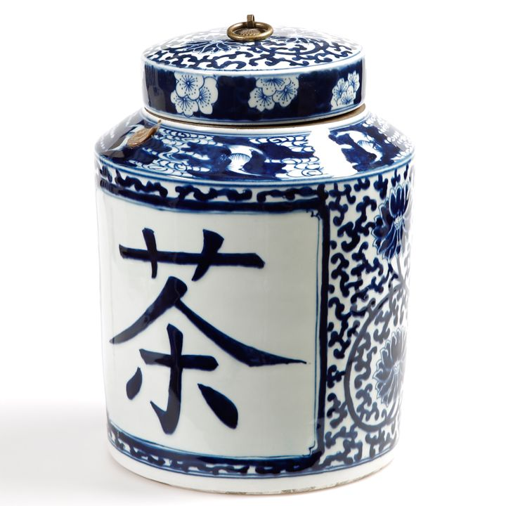 "blue and white Chinese tea caddy, Chinese characters reading ""Tea"" lettered on the side w/ floral and filigree decoration, cylinder shape w/ shoulders rising to cap lid, brass ring knob, handpainted ceramic, China"