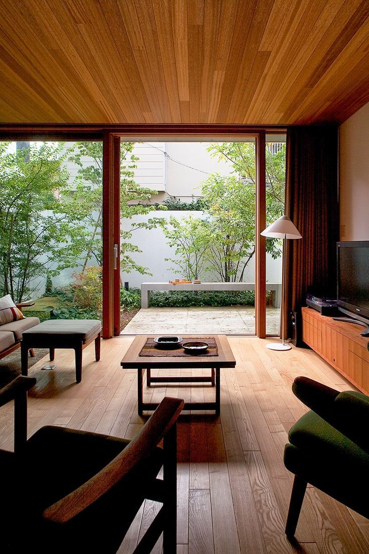 Simple living room with floor-to-ceiling windows.