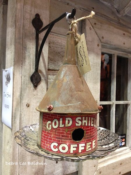 Another booth sold repurposed objects, like this birdhouse made of a metal funnel, a tin of coffee, and a vegetable steamer.