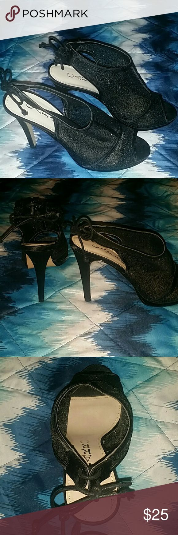 Black open toe heels Size 8 black (with silver sparkles) open toe heels, ties at the back, the heels are 4 inches high.  Man nade uppers, leather soles. Caparros Shoes Heels
