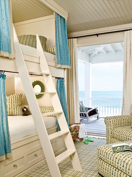 In this beachside bunkroom in South Carolina, a pop of solid color against the small-scale print anchors the space while still keeping the mood light and the look cohesive. The rug picks up on the other blues so that the patterns can coordinate, not clash. (Photo: J. Savage Gibson)
