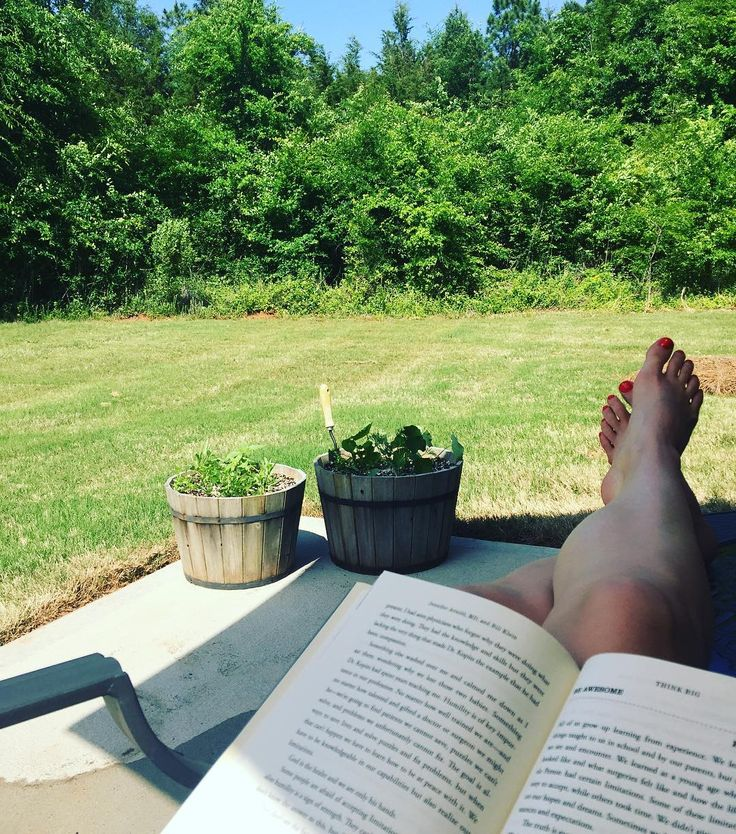 This is the life. Perfect Saturday weather! Sitting on our patio and reading. Please let this weather stay a little longer in #clt. I am even wearing shorts thanks to @alloutsportsperformance and @tgib81 I don't think I wore shorts before I started working out with him! #nomorelumpy #hardworkpaysoff #spring #outdoors #reading #thelife #itworks #trophywife