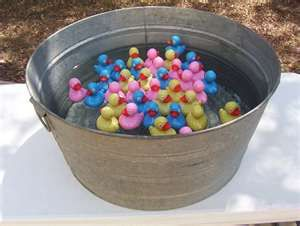Carnival game staples like Pick up a duck. You can put numbers on the bottom of the ducks with a Sharpie to see which prize they won.