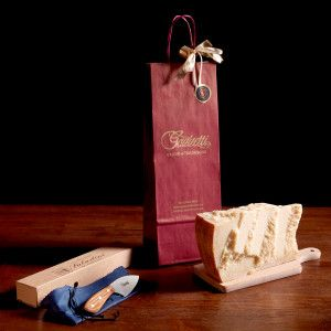 """Burgundy gift bag with  """"Gazzetti"""" log containing 1kg of 24 month aged #Parmesan and a cheese knife in olive wood and sheared blade.  #gazzettifood #gazzetti #italianfood #christmas"""