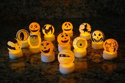 from booturtle: make your own halloween tea lights. those are ping pong balls…