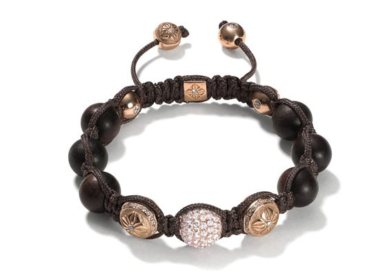 Shamballa Jewels http://www.vogue.fr/joaillerie/shopping/diaporama/ebene-bijoux-bois-or-noor-lydia-courteille-van-cleef-arpels-vhernier/11575/image/683147#shamballa-jewels-ebene-bois-or-bijoux