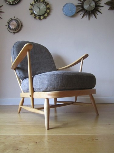 Yum, Ercol chair and wall of clocks, ace.